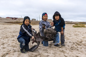 Young Inuit geese hunters, Gjoa Haven, Canada